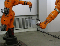 Two cooperating robots